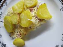 Potato bake with smoked meat and sauerkraut
