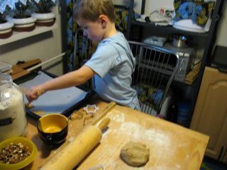 Cut cookies, put them on a baking tin