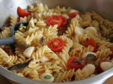 Pasta salad with mozzarella and rolled anchovy eyes