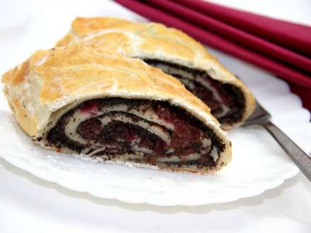 Cherry and poppy seed strudel made of puff pastry