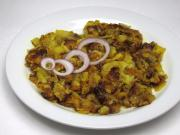 Fried spicy potatoes with onions