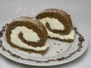 Gingerbread roll with whipped cream