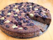 Banana pie with gooseberries and blueberries